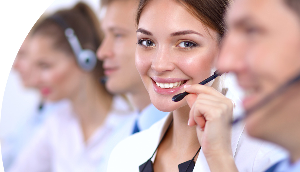 Customer Support Agent smiling in front of camera